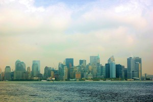 NYC skyline photographed from Lady Liberty. Construction cranes just to the left of center is the 911 site.